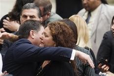 Actress Aida Turturro embraces a fellow mourner as she arrives for the funeral services of James Gandolfini outside the Cathedral Church of Saint John the Divine in New York June 27, 2013. REUTERS/Lucas Jackson