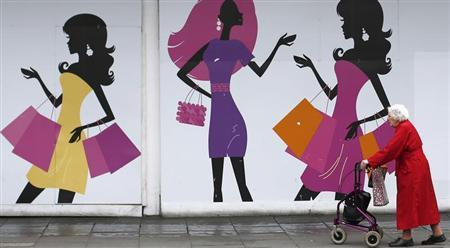 A shopper walks past an empty retail unit in Nottingham, central England, June 6, 2013. REUTERS/Darren Staples