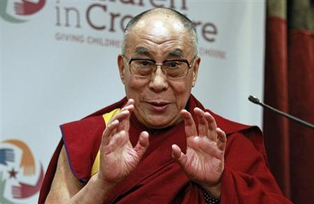 Tibetan spiritual leader the Dalai Lama speaks during his visit to the Children in Crossfire charity in Londonderry, northern Ireland April 18, 2013. REUTERS/Cathal McNaughton