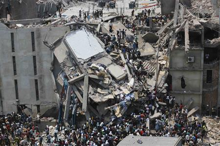 People rescue garment workers trapped under rubble at the Rana Plaza building after it collapsed, in Savar, 30 km (19 miles) outside Dhaka in this April 24, 2013 file photo. REUTERS/Andrew Biraj/Files