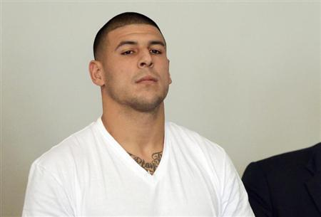 New England Patriots tight end Aaron Hernandez is arraigned on charges of murder and weapons violations in Attleborough, Massachusetts, after being arrested, June 26, 2013. REUTERS/Mike George/Pool