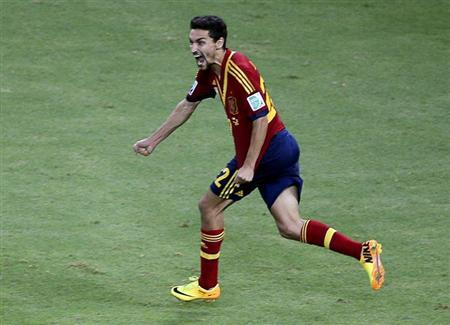 Spain's Jesus Navas celebrates after scoring the winning penalty during the penalty shootout of their Confederations Cup semi-final match against Italy at the Estadio Castelao in Fortaleza June 27, 2013. REUTERS/Paulo Whitaker