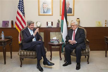 U.S. Secretary of State John Kerry (L) speaks with Palestinian President Mahmoud Abbas in Amman June 28, 2013. REUTERS/Jacquelyn Martin/Pool