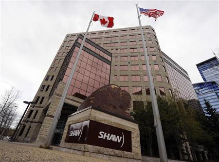 Flags fly over the Shaw Communications corporate headquarters in Calgary, Alberta May 3, 2010. REUTERS/Todd Korol