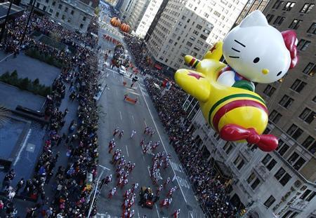 A Hello Kitty balloon float makes its way down 6th Ave during the Macy's Thanksgiving Day Parade in New York, November 22, 2012. REUTERS/Carlo Allegri