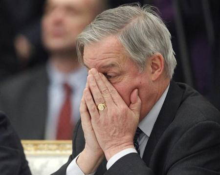 French central bank Governor Christian Noyer reacts during a meeting of G20 representatives with Russian President Vladimir Putin in the Kremlin February 15, 2013. REUTERS/Maxim Shemetov