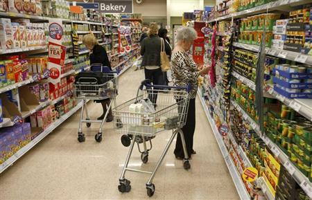 Customers shop for groceries in a supermarket in London October 18, 2011. REUTERS/Neil Hall/Files
