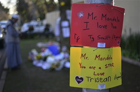 Messages of support hang on a pole outside the home of former South African President Nelson Mandela, in Houghton, Johannesburg June 28, 2013. REUTERS-Mujahid Safodien