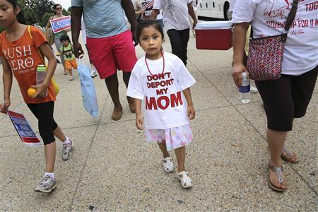 A girl wears a ''Don't Deport My Mom t-shirt'' as she joins immigrants and activists, led by Service Employees International Union (SEIU) and CASA, as they chant and march to urge congress to act on immigration reform, on Capitol Hill in Washington, June 26, 2013. REUTERS/Jonathan Ernst