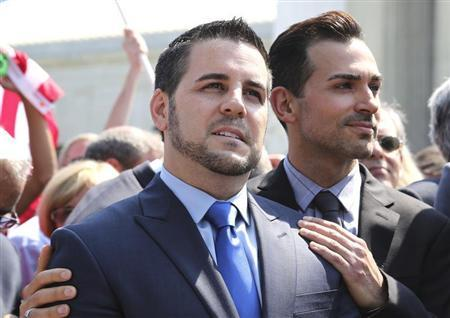 Jeff Zarrillo (L) and Paul Katami, plaintiffs in the case against California's gay marriage ban known as Prop 8, stand together in front of reporters as they depart the Supreme Court in Washington, June 26, 2013. REUTERS/Jonathan Ernst