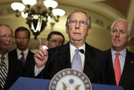 U.S. Senate Minority Leader Mitch McConnell (R-KY) (2nd R) speaks to the media on Capitol Hill in Washington June 18, 2013. REUTERS/Yuri Gripas