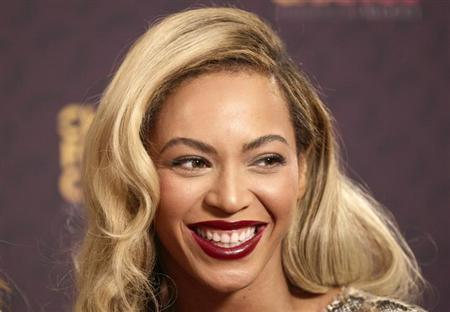 Singer Beyonce poses for photographs at ''The Sound of Change'' concert at Twickenham Stadium in London June 1, 2013. REUTERS/Neil Hall