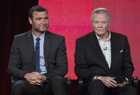 Actors Liev Schreiber (L) and Jon Voight of the show ''Ray Donovan'' listen to a question on stage during the Showtime panel presentation of the 2013 Winter Television Critics Association Press Tour at the Langham Huntington Hotel in Pasadena, California, January 12, 2013. REUTERS/Bret Hartman