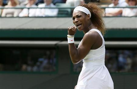 Serena Williams of the U.S. reacts to breaking serve in the second set during her women's singles tennis match against Caroline Garcia of France at the Wimbledon Tennis Championships, in London June 27, 2013. REUTERS/Stefan Wermuth