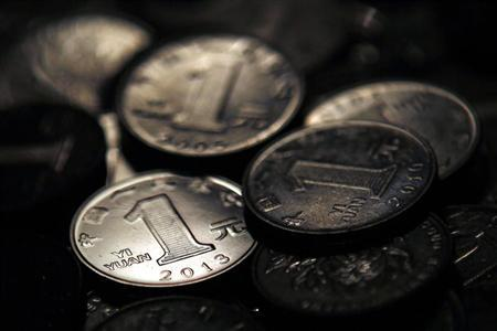 One Chinese yuan coins are seen in this photo illustration taken in Shanghai April 7, 2013. REUTERS/Carlos Barria