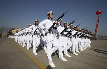 New recruits of the Chinese Navy march with their guns during the parade marking the end of their first training session in Qingdao, Shandong province, March 4, 2013. REUTERS/Stringer