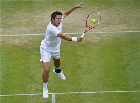Igor Sijsling of the Netherlands hits a volly to Milos Raonic of Canada during their men's singles tennis match at the Wimbledon Tennis Championships, in London June 27, 2013. REUTERS/Toby Melville