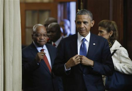 U.S. President Barack Obama (C) arrives at a joint news conference with South Africa's President Jacob Zuma (L) at the Union Buildings in Pretoria, June 29, 2013. REUTERS/Jason Reed