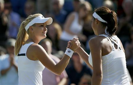 Agnieszka Radwanska of Poland (L) shakes hands with Madison Keys of the U.S. after defeating her in their women's singles tennis match at the Wimbledon Tennis Championships, in London June 29, 2013. REUTERS/Stefan Wermuth