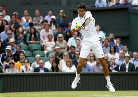 Novak Djokovic of Serbia hits a return to Jeremy Chardy of France in their men's singles tennis match at the Wimbledon Tennis Championships, in London June 29, 2013. REUTERS/Eddie Keogh