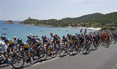 The pack of riders cycles along the coast as it makes its way during the 213 km first stage of the centenary Tour de France cycling race from Porto-Vecchio to Bastia, on the French Mediterranean island of Corsica June 29, 2013. REUTERS/Eric Gaillard
