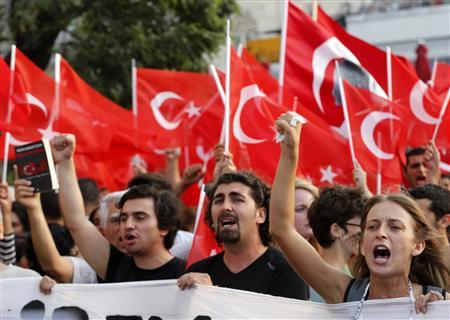 Protesters shout slogans during an anti-government protest at Taksim Square in Istanbul June 29, 2013. REUTERS/Umit Bektas