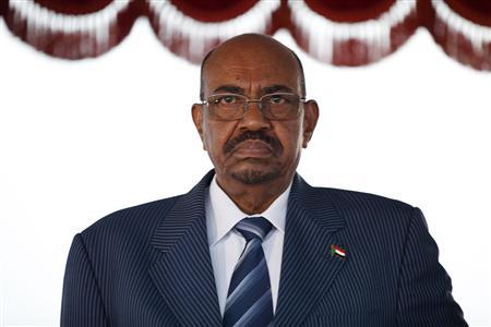 Sudanese President Omar Hassan al-Bashir stands for the national anthem on arrival at Bole International airport for the 21st Ordinary Session of the African Union (AU) in Addis Ababa May 24, 2013. REUTERS/Tiksa Negeri