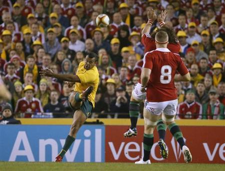 Australia Wallabies' Kurtley Beale (L) kicks the ball during their rugby union test match against the British and Irish Lions at the Etihad Stadium in Melbourne June 29, 2013. REUTERS/David Gray