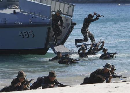 Philippine Military Academy (PMA) cadets move ashore from a navy ship during a joint field training exercise at the Marines' training centre in Ternate, Cavite city, south of Manila May 29, 2013. REUTERS/Romeo Ranoco/Files