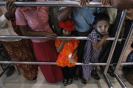 Children wait for their relatives to return from Malaysia in Yangon International Airport in Yangon June 15, 2013. REUTERS/Soe Zeya Tun