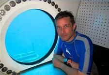 Fabien Cousteau, the grandson of famed French oceanographer Jacques-Yves Cousteau, sits in the Aquarius undersea marine habitat and lab located in the Florida Keys National Marine Sanctuary near Key Largo, in this handout photo taken April 2013. REUTERS/Mission 31/Handout via Reuters