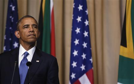 U.S. President Barack Obama listens to South Africa's President Jacob Zuma's remarks at a joint news conference at the Union Building in Pretoria June 29, 2013. REUTERS/Gary Cameron