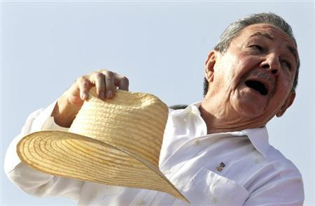 Cuba's President Raul Castro puts his hat on after waving to the crowd at the annual May Day parade at Havana's Revolution Square May 1, 2010. REUTERS/Enrique De La Osa