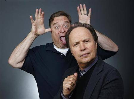 Actors John Goodman (L) and Billy Crystal pose for a portrait while promoting the animated film ''Monsters University'' in Beverly Hills, California May 18, 2013. REUTERS/Danny Moloshok
