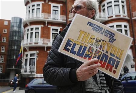 A supporter of Edward Snowden holds a sign that reads ''Thank You Ecuador'', outside the Embassy of Ecuador in London June 24, 2013. WikiLeaks founder Julian Assange said on Monday that fugitive U.S. spy agency contractor Snowden had received refugee papers from the Ecuador government to secure him safe passage as he fled Hong Kong over the weekend. REUTERS/Luke MacGregor