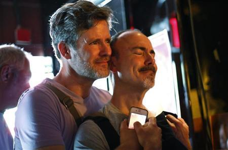 Patrons watch coverage of the U.S. Supreme Court ruling on the Defense of Marriage Act at the Stonewall Inn in New York June 26, 2013. REUTERS/Brendan McDermid