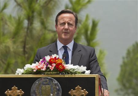 British Prime Minister David Cameron speaks during a joint news conference with Pakistan's Prime Minister Nawas Sharif (not pictured) in Islamabad June 30, 2013. REUTERS/Mian Khursheed (PAKISTAN - Tags: POLITICS HEADSHOT) - RTX116R6