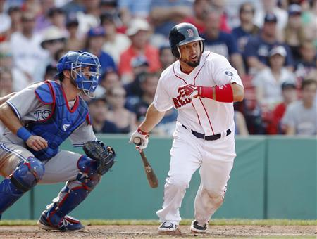 Boston Red Sox's Shane Victorino grounds into a fielding error to drive in the walk-off run in the ninth inning against the Toronto Blue Jays during their MLB American League East baseball game in Boston, Massachusetts, June 30, 2013. REUTERS/Dominick Reuter