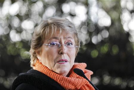 Former Chilean President Michelle Bachelet speaks to the media after casting her ballot during presidential local primary elections in Santiago June 30, 2013. REUTERS/Eliseo Fernandez