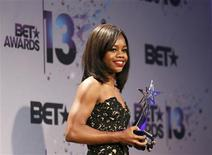 Olympic gymnast Gabrielle Douglas poses backstage with her youngstars award at the 2013 BET Awards in Los Angeles, California June 30, 2013. REUTERS/Danny Moloshok