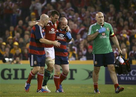 British and Irish Lions' Sam Warburton (2nd L) is assisted from the field during their rugby union test match against the Australia Wallabies at the Etihad Stadium in Melbourne June 29, 2013. REUTERS/David Gray