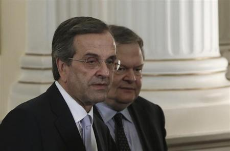 Greece's Prime Minister Antonis Samaras (L) and newly appointed Foreign Minister and Deputy Prime Minister Evangelos Venizelos walk after a swearing in ceremony at the Presidential Palace in Athens June 25, 2013. REUTERS/John Kolesidis