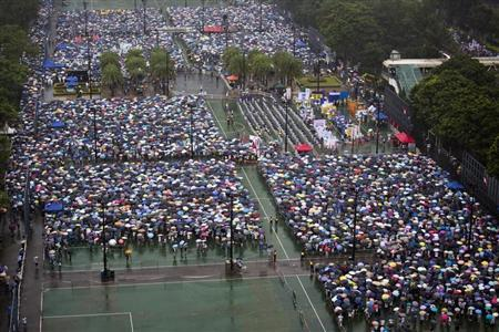 Thousands of pro-democracy protesters gather to march in the streets to demand universal suffrage and urge Hong Kong's Chief Executive Leung Chun-ying to step down in Hong Kong July 1, 2013. REUTERS/Tyrone Siu