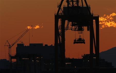 A crane is seen at an industrial port in Tokyo November 15, 2012. REUTERS/Kim Kyung-Hoon