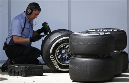 A Pirelli technician works on a tyre during the British Grand Prix at the Silverstone Race circuit, central England, June 30, 2013. REUTERS/Darren Staples
