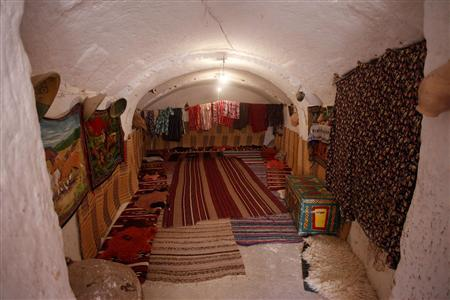 The interior of a troglodyte cave house is seen in the western mountain  town of Gharyan  100 km  62 miles  south of Tripoli  June 15  2013 Going underground  Libya s unusual cave dwellings. Underground Cave Home. Home Design Ideas