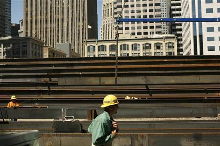 Workers guide steel beams into place at a construction site in San Francisco, California September 1, 2011. REUTERS/Robert Galbraith
