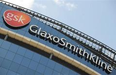 Signage is pictured on the company headquarters of GlaxoSmithKline in west London in this July 21, 2008 file photo. REUTERS/Toby Melville
