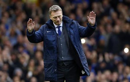 Everton's manager David Moyes waves goodbye after their English Premier League soccer match against West Ham United at Goodison Park in Liverpool, northern England, May 12, 2013. REUTERS/Darren Staples