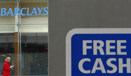 A woman walks past a Barclays Bank in Leicester, central England April 24, 2013. REUTERS/Darren Staples